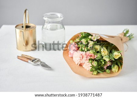 Bouquet 015. step by step installation of flowers in a vase. Flowers bunch, set for home. Fresh cut flowers for decoration home. European floral shop. Delivery fresh cut flower. Royalty-Free Stock Photo #1938771487