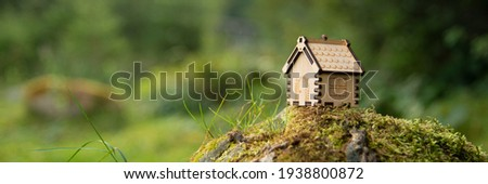 Miniature wooden house . The concept of buying a house or apartment. Affordable housing. Profitable and cheap loans for real estate. Buying a home. Mortgage and loan. Place for text