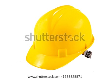 Yellow hard hat for construction workers. Protective clothing and accessories for employees. Light background. Royalty-Free Stock Photo #1938828871
