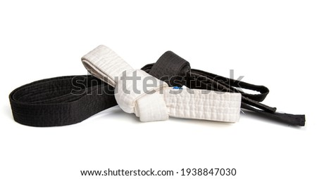 Black belt top skill and white entry level martial arts tied in a knot and isolated on white background Royalty-Free Stock Photo #1938847030