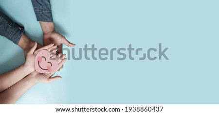 Couple hands holding paper cut red heart, family insurance, CSR, world heart day, health care, love, organ donation,  world health day, wellbeing, gratitude, be kind, be thankful, praying concept Royalty-Free Stock Photo #1938860437