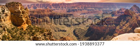 Amazing pano view of the Grand Canyon from the south rim.  The convoluted gorge formed over millions of years by the Colorado River (visiable in this image), erosion, and gravity.  Incredible vista!  Royalty-Free Stock Photo #1938893377