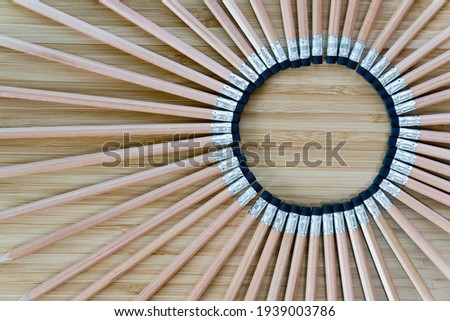 A top view image of several sharpened pencil on a wooden table. concept