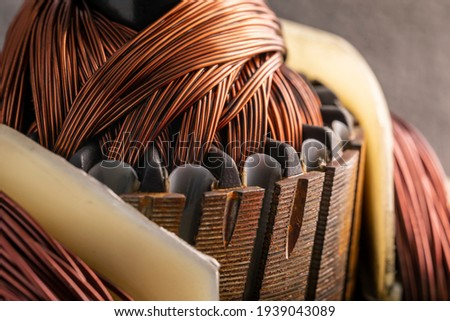 Rotor of an electric motor close up. Copper motor windings. Royalty-Free Stock Photo #1939043089