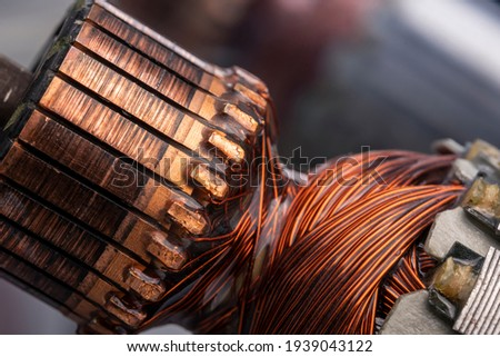Copper commutator bar of the electric motor close up. Electric motor rotor. Royalty-Free Stock Photo #1939043122