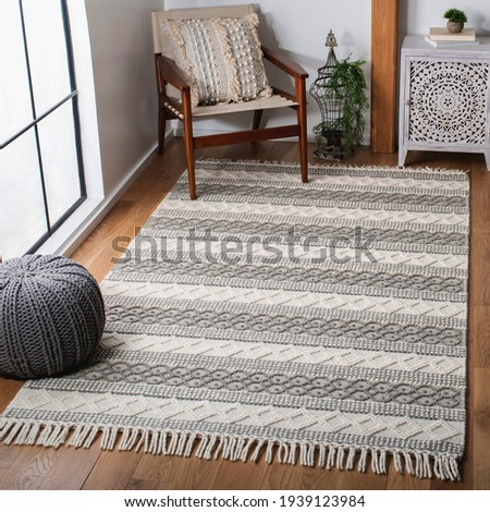 Handwoven geometric tassel shag Area rug. Royalty-Free Stock Photo #1939123984