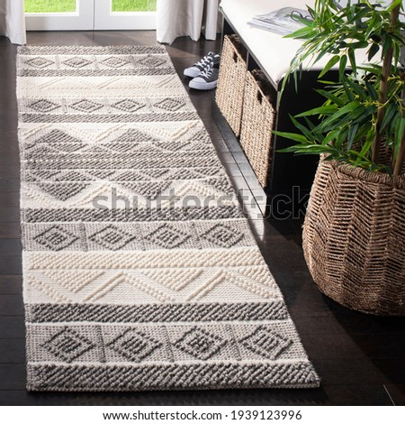 Handwoven geometric tassel shag Area rug. Royalty-Free Stock Photo #1939123996