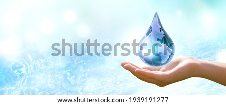 Water Day or World Oceans Day concept. Environmental conservation and Climate literacy, save, protect clean planet Earth and ecology, sustainable lifestyle. Drop in human hand on pure sea background. Royalty-Free Stock Photo #1939191277