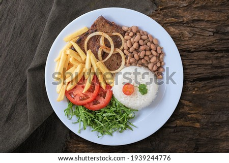 Typical Brazilian food dish Top view. Royalty-Free Stock Photo #1939244776