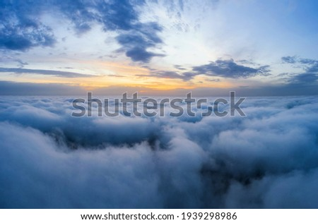 Beatuful dawn sky over clouds high. Aerial cloudscape photography. Royalty-Free Stock Photo #1939298986