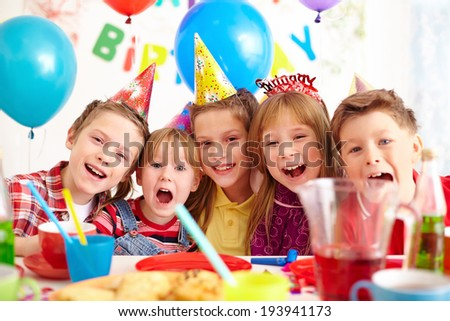 Group of adorable kids looking at camera at birthday party #193941173
