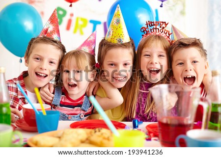 Group of adorable kids looking at camera at birthday party #193941236