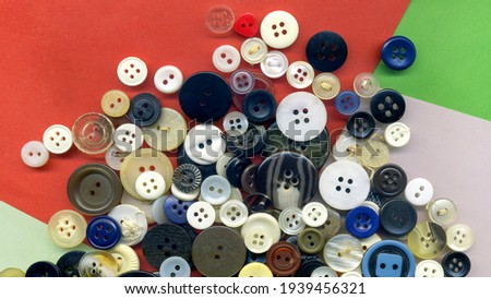 Close up buttons, macro colorful image. Collection of assorted spare clothes buttons vintage. Sewing tools. Color buttons frame on fabric texture background wallpaper Royalty-Free Stock Photo #1939456321