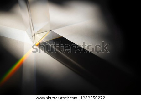 rainbow spectrum in a glass prism with shadow from the sun light