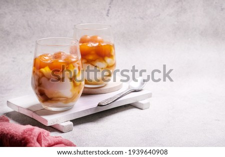 Bubur sumsum biji salak or candil is Indonesian traditional dessert, made of sweet potato and rice flour served with brown sugar syrup in glass. Popular food during Ramadhan.  Royalty-Free Stock Photo #1939640908