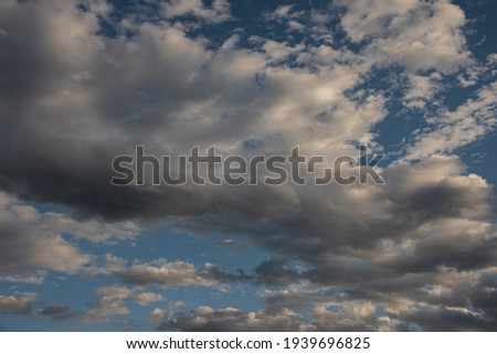 Clouds in the sky. The wonderful spectacle of a sky full of clouds. Depth and three-dimensionality of a cloudy sky. Royalty-Free Stock Photo #1939696825