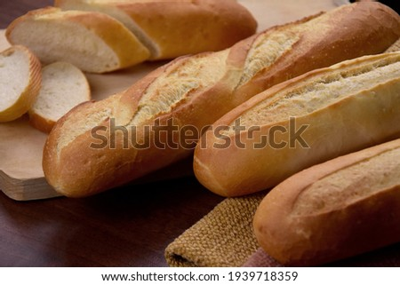 French baguettes on the table close-up stock images. Pile of french bread still life stock photo. Fresh baguettes detail images