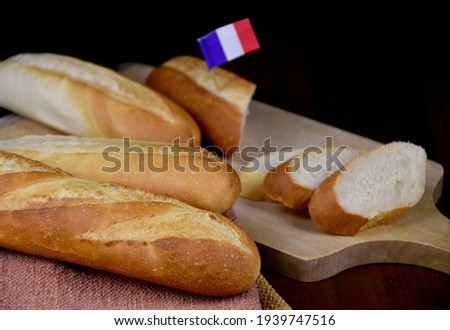 French baguettes on the table close-up stock images. Pile of french bread with french flag still life stock photo. Fresh baguettes detail images