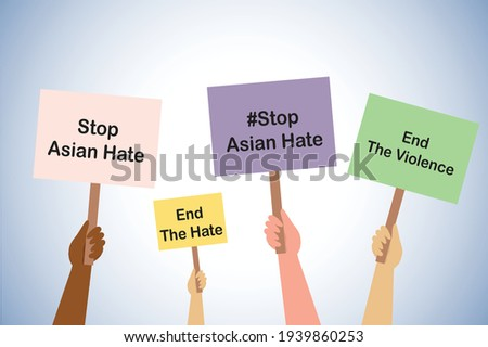Stop Asian hate and Stop violence, hands holding stop Asian hate placards  Royalty-Free Stock Photo #1939860253