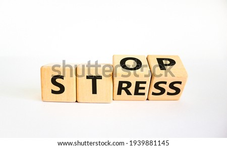 Stop stress and be health symbol. Turned cubes and changed words 'stress' to 'stop'. Beautiful white background. Psychological, business and stop stress concept. Copy space.