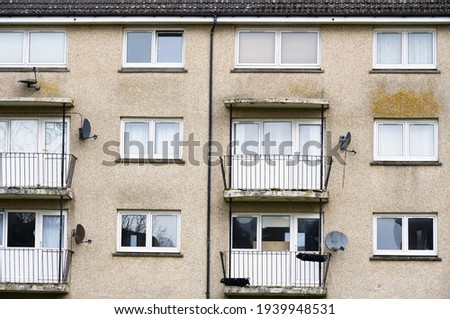 Derelict council house in poor housing estate slum with many social welfare issues in Port Glasgow Royalty-Free Stock Photo #1939948531
