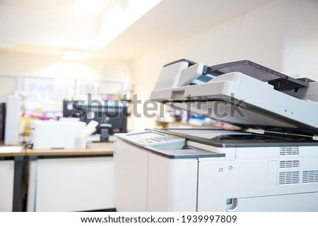 Close-up the copier machine in office copy room for scanning document printing a sheet and xerox photocopy and concepts of use a photocopier. Royalty-Free Stock Photo #1939997809