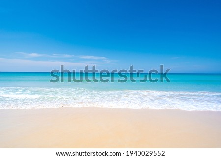Nature landscape view of beautiful tropical beach and sea in sunny day. Beach sea space area Royalty-Free Stock Photo #1940029552
