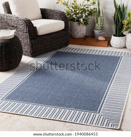 Modern indoor outdoor area rug. Royalty-Free Stock Photo #1940086453