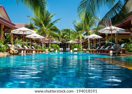 beautiful swimming pool in tropical resort , Phuket, Thailand.  Royalty-Free Stock Photo #194018591