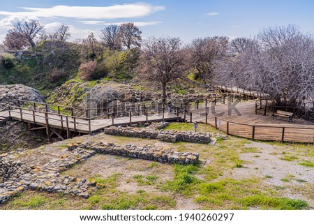 Wall and archaeological remains inside the archaeological park of the ancient city of Troy near Canakkale, Western Turkey Royalty-Free Stock Photo #1940260297