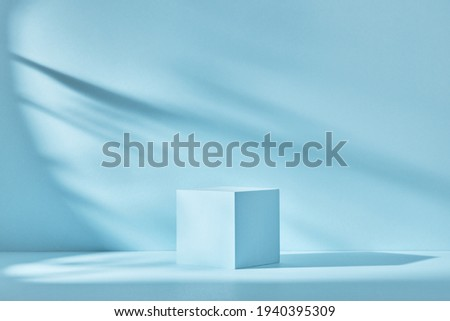 Blue background for product presentation with shadows and light. Empty cubic podium. Mockup. Royalty-Free Stock Photo #1940395309