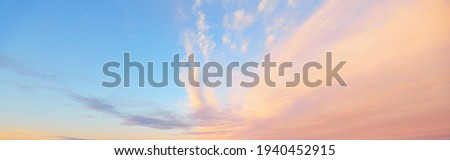 Clear blue sky, red, pink, golden cirrus and cumulus clouds after storm. Dramatic sunset cloudscape. Concept art, meteorology, heaven, hope, peace, graphic resources, picturesque panoramic scenery Royalty-Free Stock Photo #1940452915