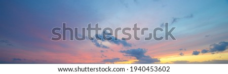 Clear blue sky, red, pink, golden cirrus and cumulus clouds after storm. Dramatic sunset cloudscape. Concept art, meteorology, heaven, hope, peace, graphic resources, picturesque panoramic scenery Royalty-Free Stock Photo #1940453602