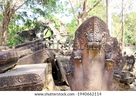 Ancient statues of multi-headed serpents or nagas and ruin of Koh Ker complex, Cambodia, Indochina. UNESCO world heritage site Royalty-Free Stock Photo #1940662114