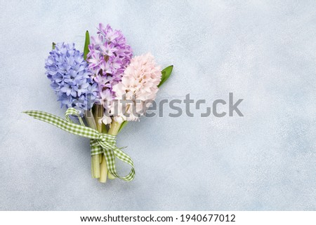 Hyacinth flowers bouquet. Easter greeting card template. Top view flat lay. With space for your greetings Royalty-Free Stock Photo #1940677012