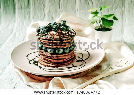 Beautiful Landscape Amoled HD Picture of Pancakes with Chocolate Syrups on Above.
