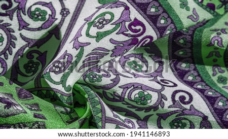 Silk fabric, royal monogram, white color, azure green on the fabric. your design will be imbued with the spirit of the Middle Ages. Textured background pattern