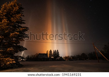 Light Pillars. Rare meteorological phenomena. Winter nature landscape.  Royalty-Free Stock Photo #1941169231