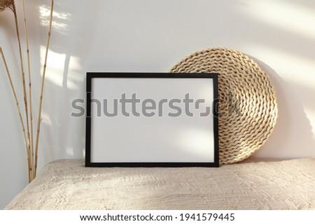 Black horizontal frame with dry cane Royalty-Free Stock Photo #1941579445