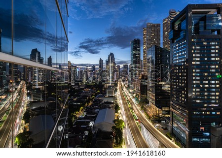 Dramatic twilight over the Kuningan business district in Jakarta, Indonesia capital city and a major financial center in Southeast Asia. Royalty-Free Stock Photo #1941618160