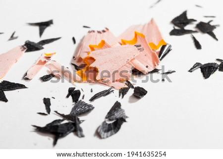 pencil shavings after sharpening, wood debris and parts of pencil lead after sharpening with a pencil sharpener