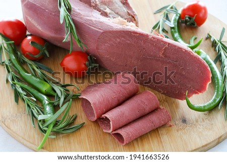 smoked beef tongue on a white background. Local name füme dana dili Royalty-Free Stock Photo #1941663526