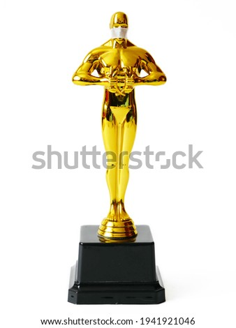 Hollywood Golden Oscar Academy award statue in medical mask isolate on white background. Success and victory concept. Oscar ceremony in coronavirus time concept