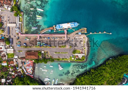 Top down view of the Padang Bai harbor in Bali, Indonesia, where trucks get out of a roro car ferry coming from Lombok Royalty-Free Stock Photo #1941941716