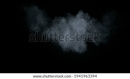 Misty chalk clouds blowing into the center. Isolated white smoke and fog wisp on black background. Studio concept and VFX plate shot for scene overlay cut out template and creative enhancement.