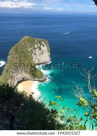 Coastline shore blue water indonesia  Royalty-Free Stock Photo #1942015327