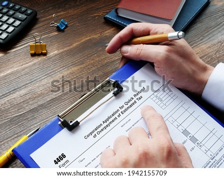 Business concept about Form 4466 Corporation Application for Quick Refund of Overpayment of Estimated Tax with sign on the page.