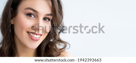 Skincare banner. Beauty enhancement. Health wellness. Relaxed happy woman with perfect smooth face skin toothy smile looking at camera isolated on white copy space commercial background.