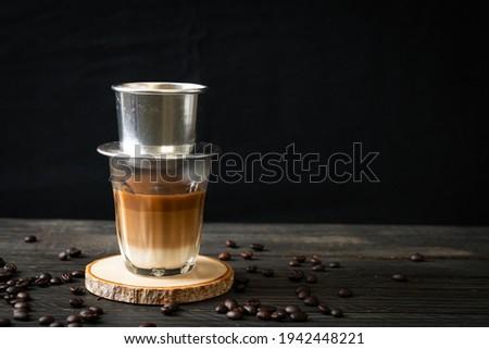 Hot milk coffee dripping in Vietnam style - Saigon or Vietnamese coffee Royalty-Free Stock Photo #1942448221