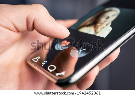 Dating app and online site in mobile phone. Swipe right or left. Beautiful single woman. Man looking for love, romance and relationship on internet with smartphone. Flirting or cheating.